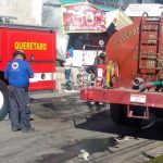 Atienden incendio de bodega en la Central de Abastos